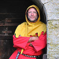 man in medieval hood and tunic